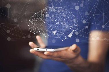 brain over smartphone in  hand