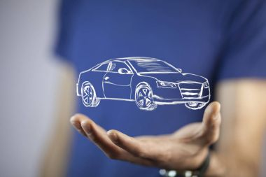 businessman's  hand with  car icon