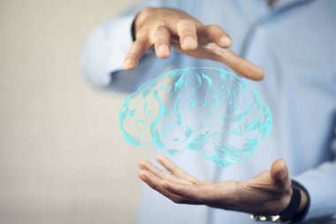 man's  hands with   brain icon