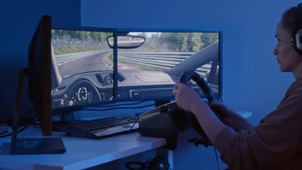 closeup view, beautiful girl playing video game with racing wheel