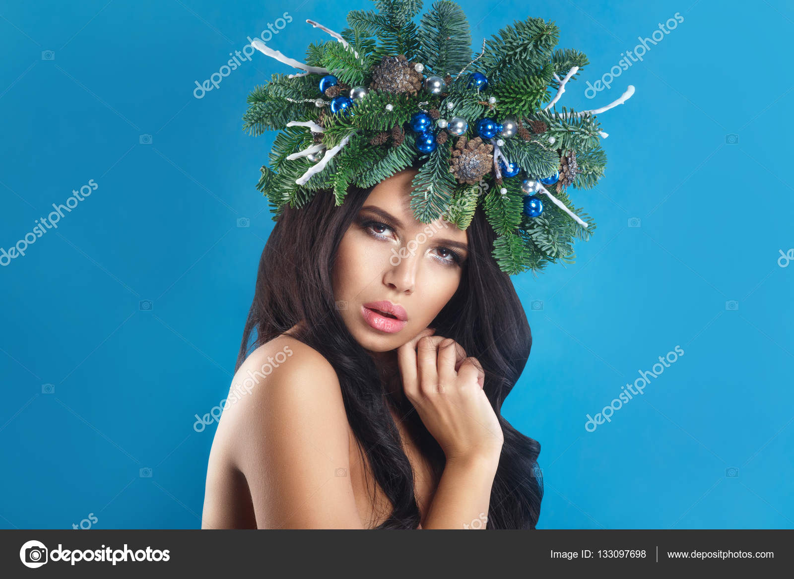 beautiful new year and christmas tree holiday hairstyle and make up beauty girl portrait over winter background colorful makeup and hair