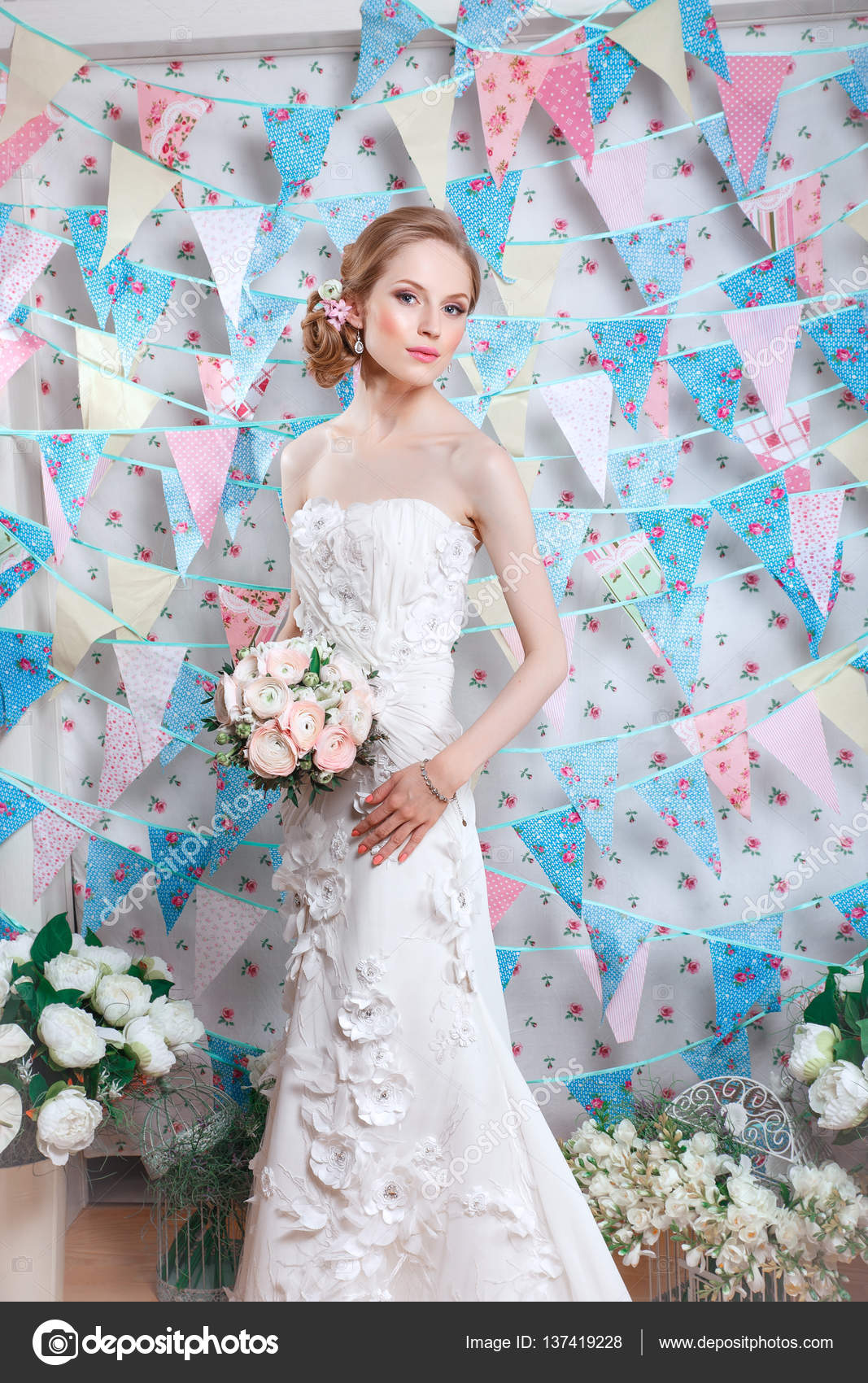 49c842ad941e Young fashion model with perfect skin and make up, flowers in hair.  Beautiful woman with makeup and hairstyle in bedroom.Happy Bride waiting  groom.
