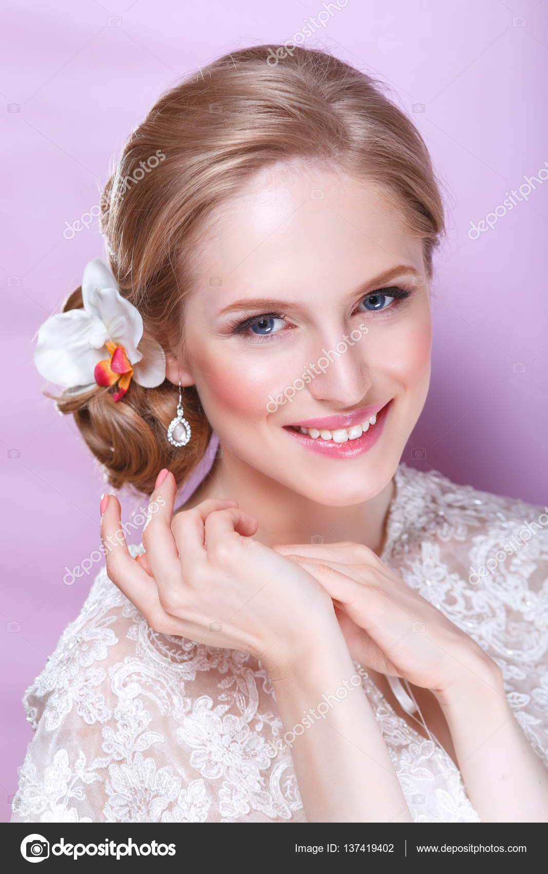 Beautiful bride with fashion wedding hairstyle - on pink background ...