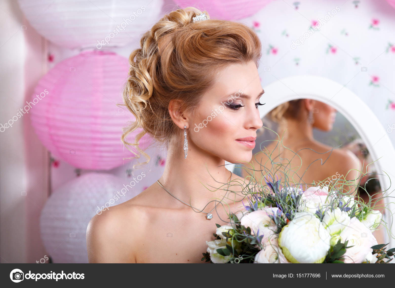 Beautiful bride with fashion wedding hairstyle and bouquet. Closeup ...