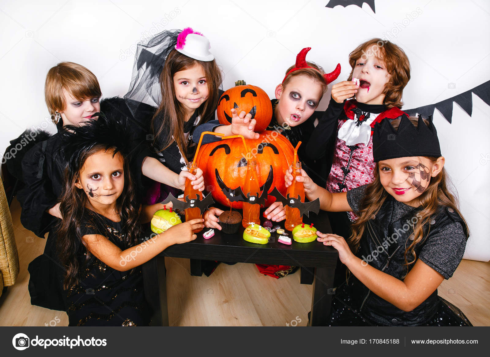halloween party. funny kids in carnival costumes — stock photo