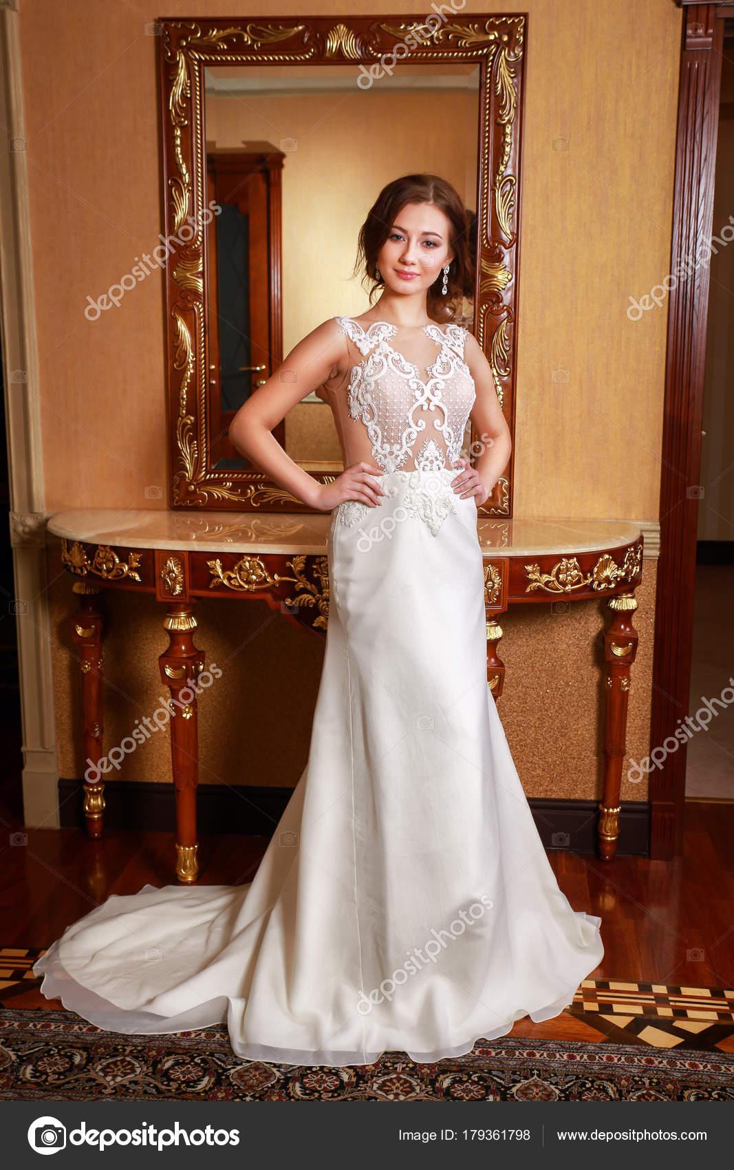 Fashion bride in gorgeous wedding dress studio portrait. Beautiful ...