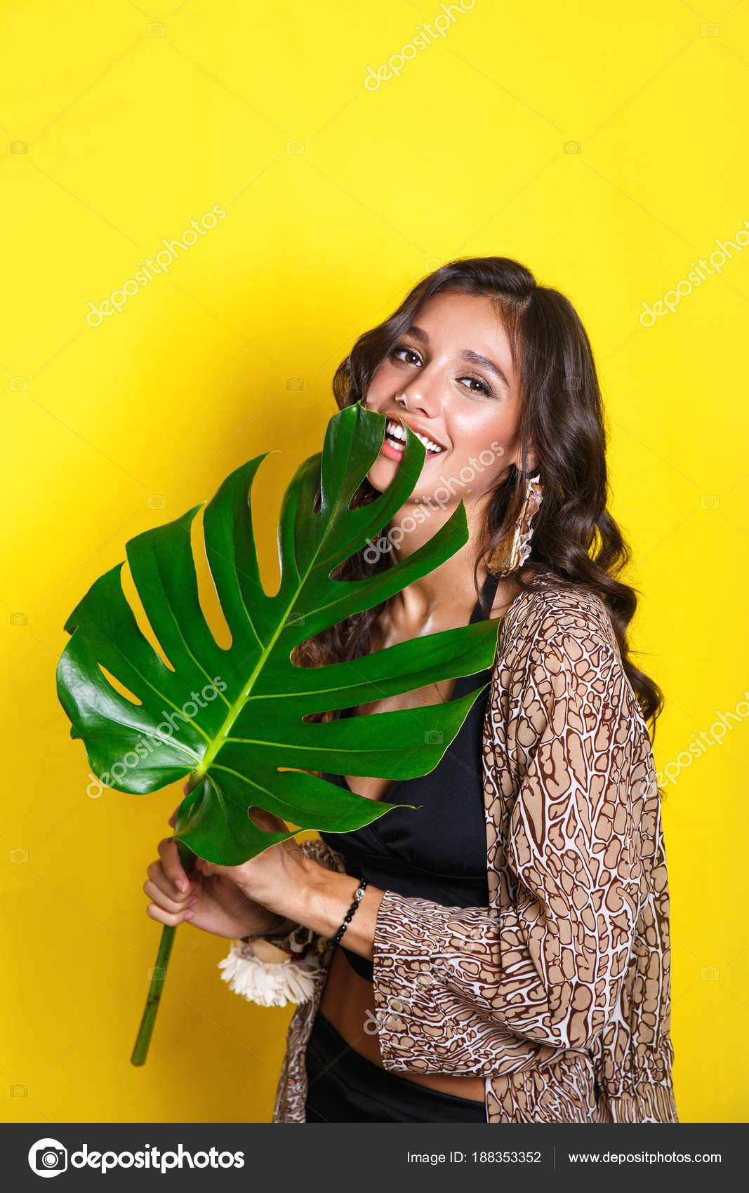 Beautiful sexy indian woman in bikini with tropical plants