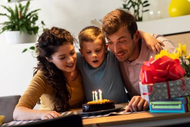 Happy family celebrating a birthday together at home