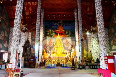 Gloden buddha statue of Wat Phra That Cho Hae temple for people