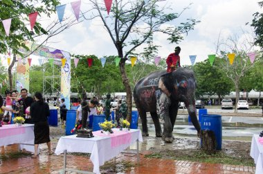 Thai people and foreigner travelers playing and splashing water