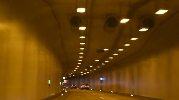 People Driving Car On The Road Passed Mountain In Car Tunnel Stock