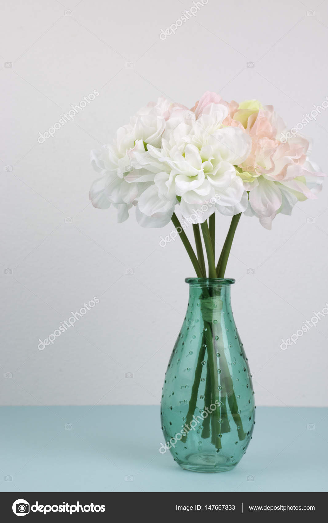 Beautiful flowers in a green vase on blue paper stock photo beautiful flowers in a green vase on blue paper photo by yanisinla izmirmasajfo
