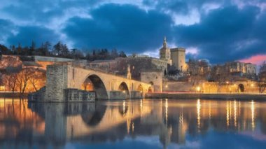 View on Pont dAvignon 12th century bridge and city skyline in Avignon, Provence, France (static image with animated sky and water)