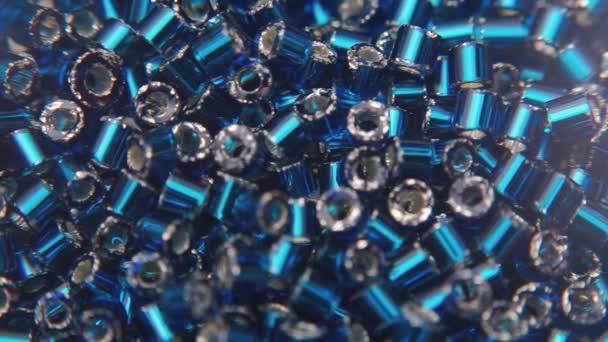 Close-up of blue metallic beads.