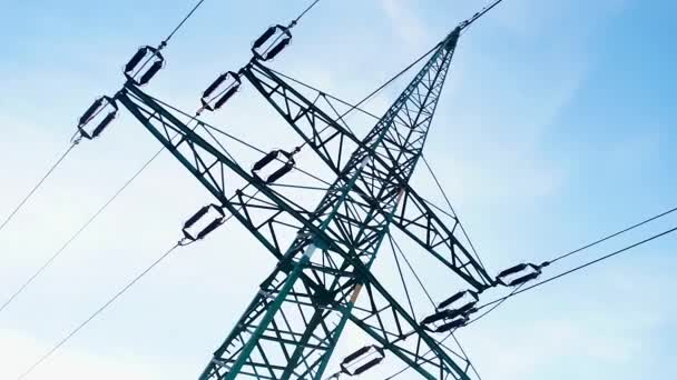 Power line tower on sky background