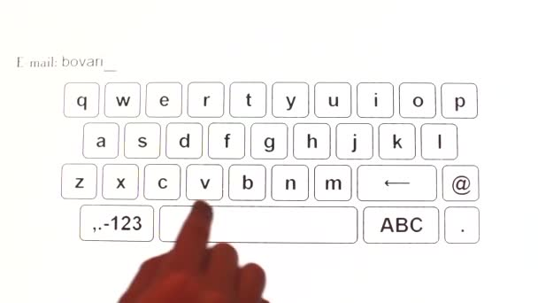 A close-up of a finger clicks on the letters of the touch keyboard.