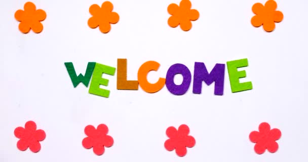 The word welcome is written in dancing letters.