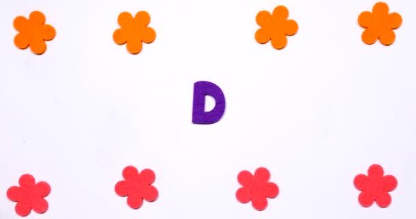 Slovo Diy. Napsáno tančícími písmeny.