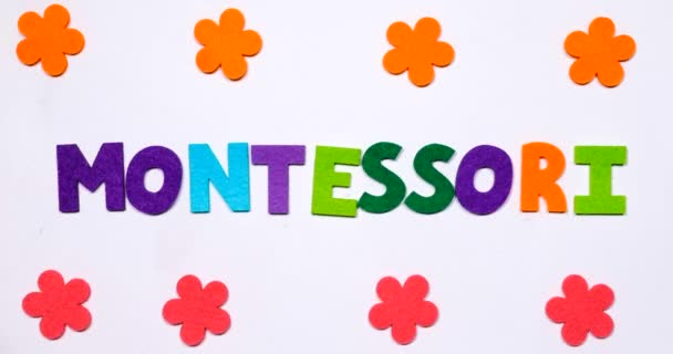 The word montessori. The word is written in dancing letters in a colorful font.