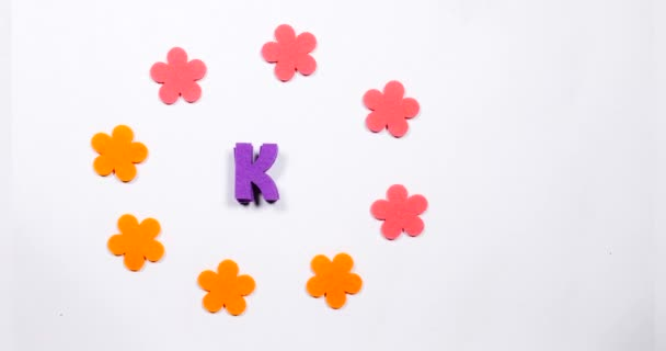 Letter K of the English alphabet. Dancing letter on a white background.