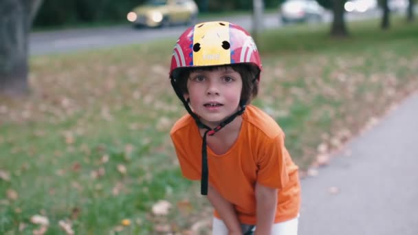 portrait of a child in a helmet that stands on a segway
