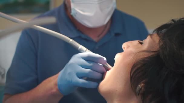 dentist treats a girl teeth in a dental clinic, drills