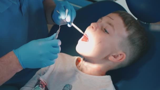 appointment with a dentist, a doctor examines the teeth of a child in a hospital