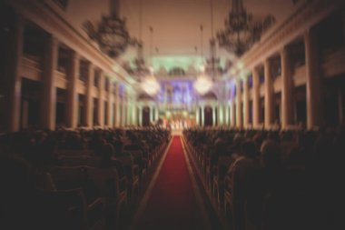 A view of philharmonia philharmonic concert hall isle with pipe organ and orchestra playing classical music in the backroun