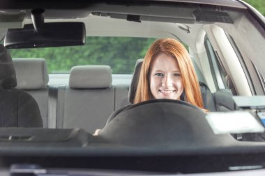 Teenage girl driving a car