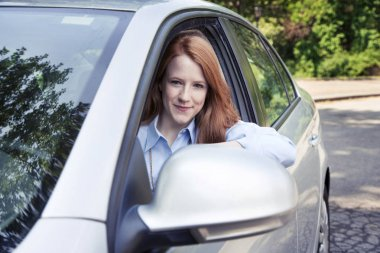 Teenager girl sitting in car