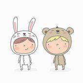 Roztomilé děti v kostýmech králík a medvěd