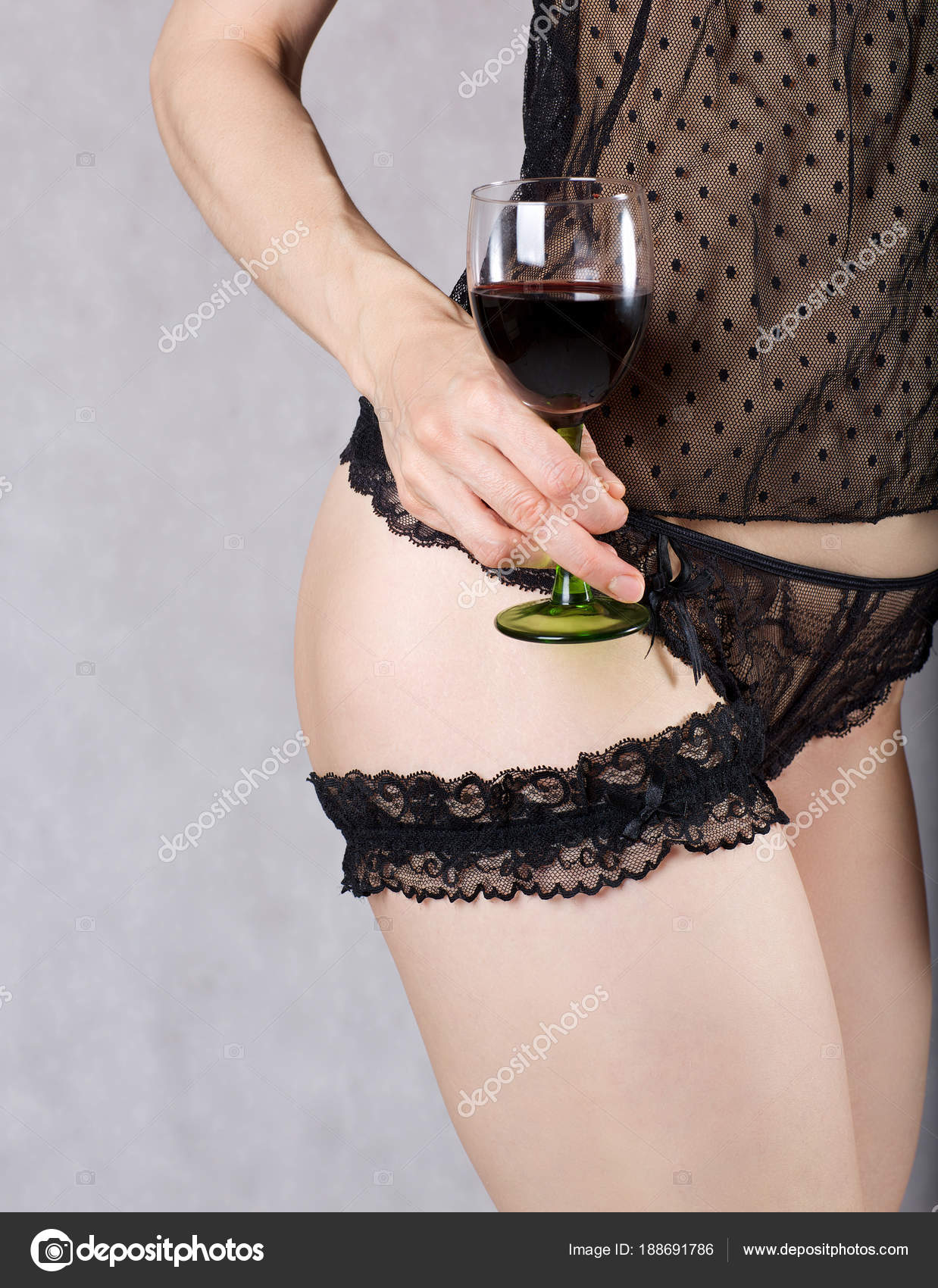 88467667b Young lady between 30 and 40 years old dressed in lingerie keeps a glass of red  wine — Photo by ...