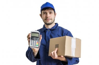 Shipment and package delivery concept. Young man holds cardboard box and payment terminal in hands. Isolated on white background.