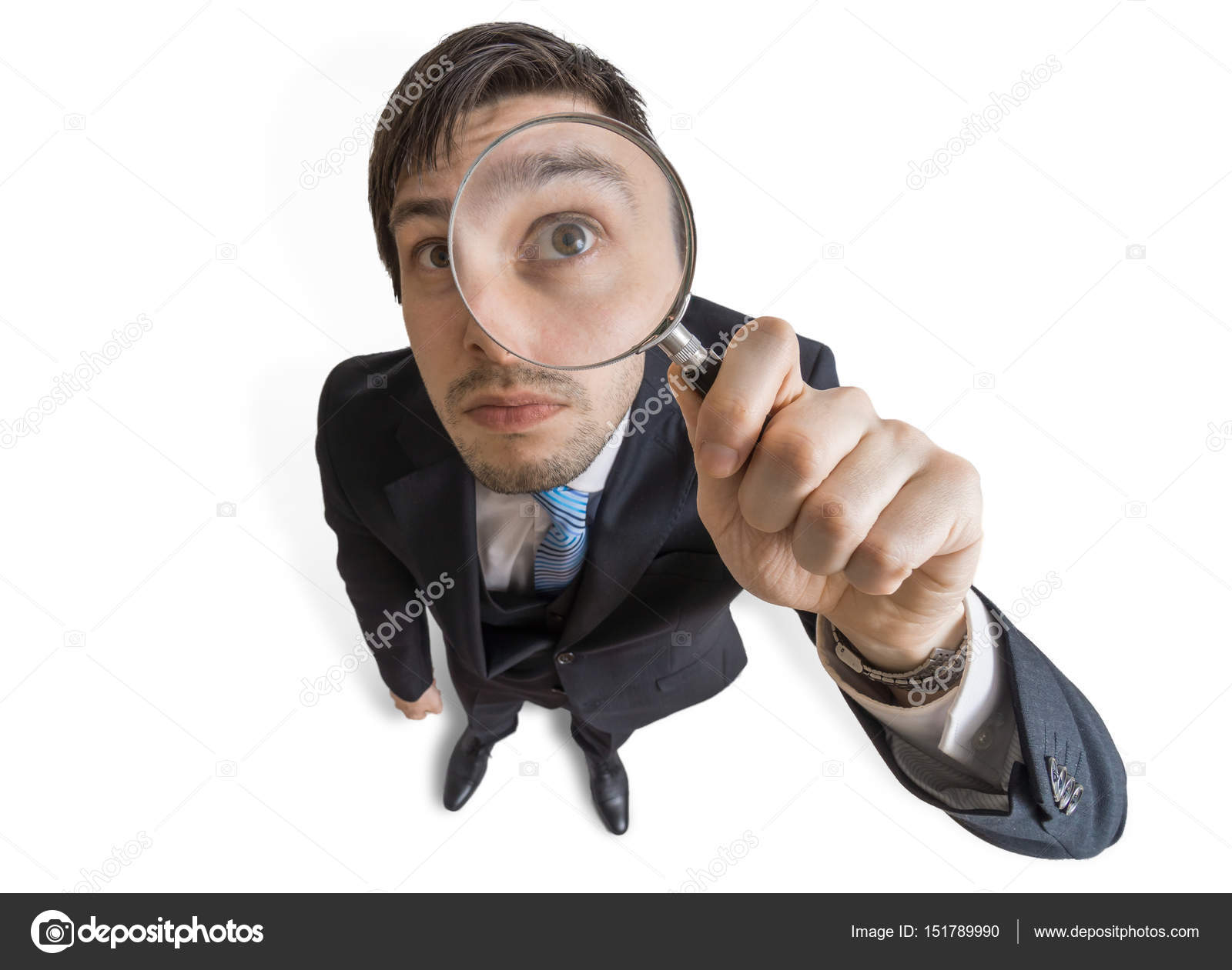 Young Man Is Looking Through Magnifying Glass. Isolated On