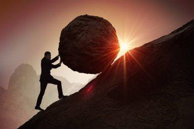 Sisyphus metaphore. Silhouette of businessman pushing heavy ston