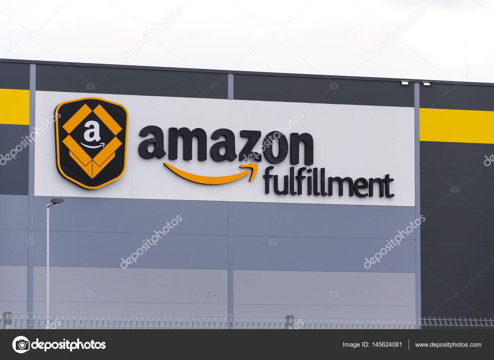 b75b366c2 DOBROVIZ, CZECH REPUBLIC - MARCH 12: Online retailer company Amazon  fulfillment logistics building on March 12, 2017 in Dobroviz, Czech  republic.