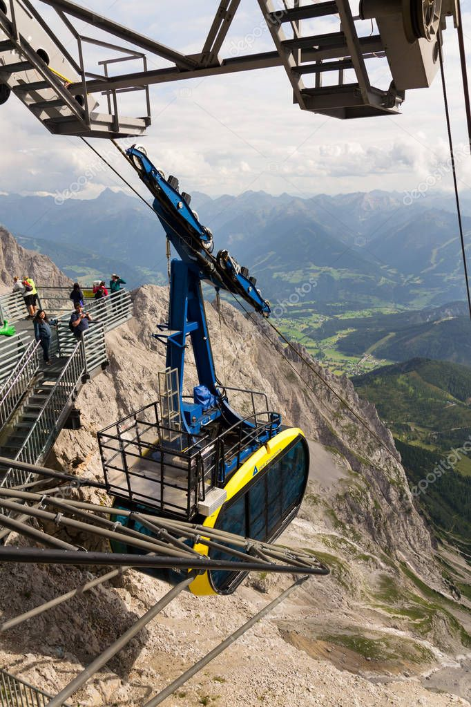 Gondola with tourists in the upper station of the Dachstein cable car