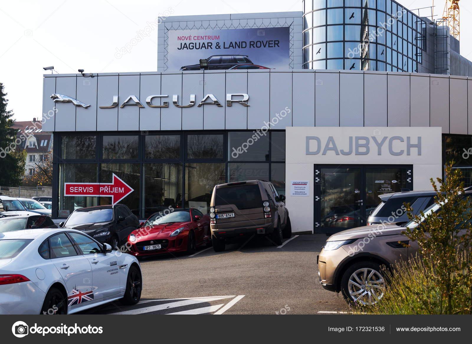 Jaguar Car Manufacturer Company Logo In Front Of Dealership Building