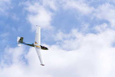 PLASY, CZECH REPUBLIC - APRIL 30: Aerobatic two-seat all-metal Let L-13AC Blanik glider for dual aerobatic training fly on April 30, 2017 in Plasy, Czech republic.