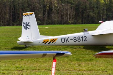PLASY, CZECH REPUBLIC - APRIL 30: Aerobatic two-seat all-metal Let L-13AC Blanik glider for dual aerobatic training stands on airfield April 30, 2017 in Plasy, Czech Republic.