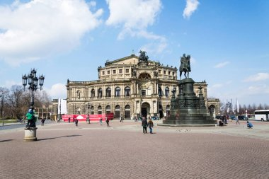 DRESDEN, GERMANY - APRIL 2 2018: People in front of King Johann horse rider statue, John of Saxony Monument and opera house Semperoper concert hall on April 2, 2018 in Dresden, Germany.