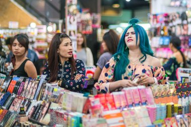 Phuket, Thailand - March 28, 2018: Cosmetics store. Girls choose
