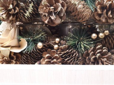close-up of abstract, bright, Christmas background from garlands, Christmas tree, decorations, snow, berries and fruits, toys, ice