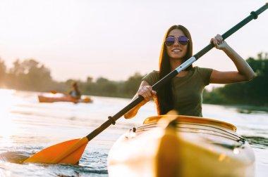 beautiful woman kayaking