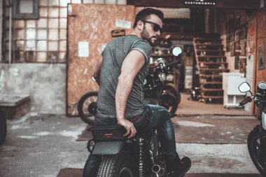 handsome man sitting on his bike