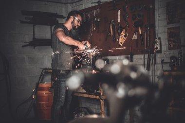 handsome welder in garage