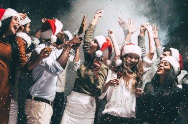 people dancing in Santa hats