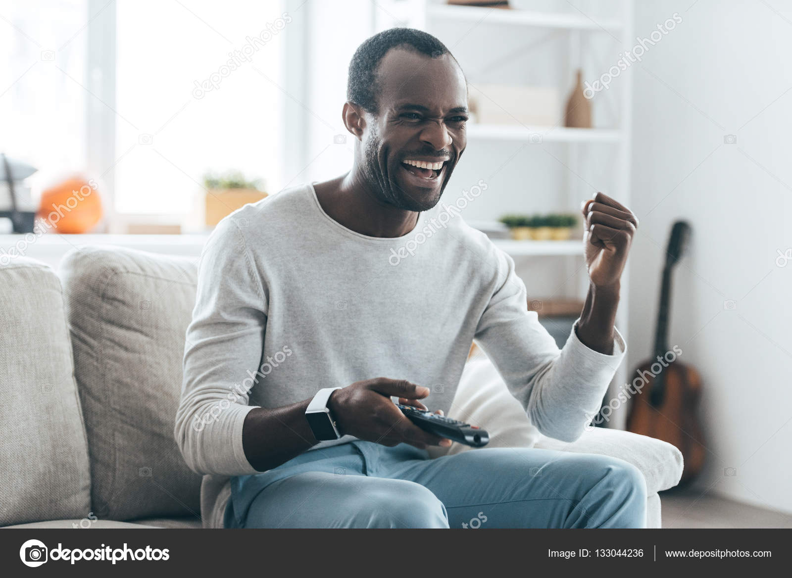 African man playing video games — Stock Photo