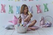 adorable girl holding little duck