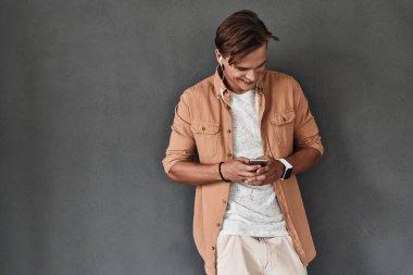 Stylish man using mobile phone